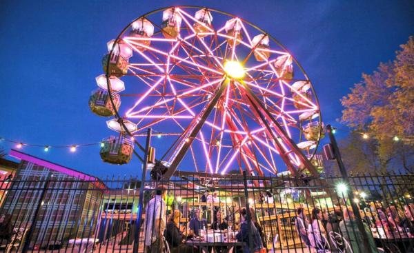 Ferris wheel lit up at night