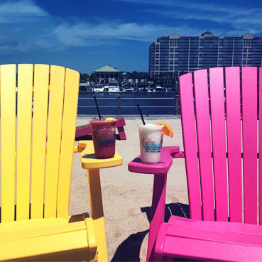 Beach chairs with drinks with Waterway in background