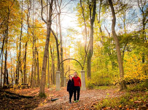 A couple enjoys the colorful fall foliage at Rose Island in Charlestown State Park near Borden, Indiana.