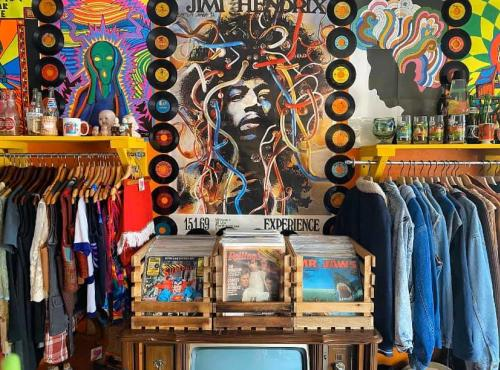 Racks of clothes and records at Odd Shop