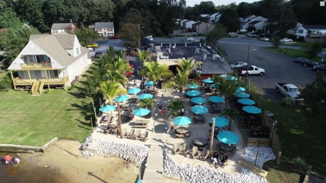 Rams Head Dockside aerial view with restaurant and outdoor patio.