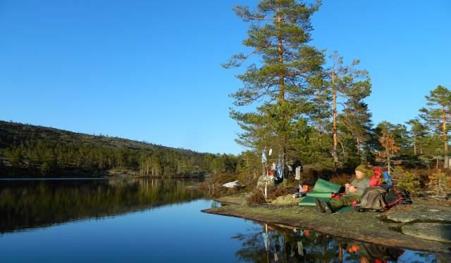 Man camping by inland lake