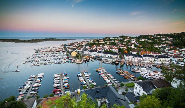 Overview of Risør harbour at dawn