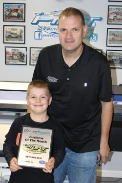 Dan Pilat and son posing with October 2020 Business of the Month Plaque