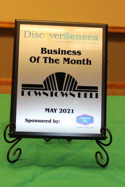 May 2021 plaque congratulating Downtown Deli as the business of the month