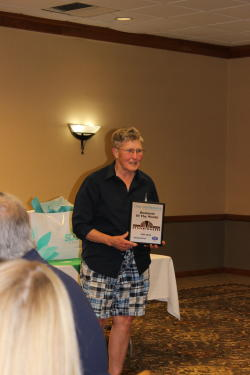 Becky Bly accepts the May Business of the Month Award on behalf of Anne Sandroni and Downtown Deli during the Chambers May Business After Hours event