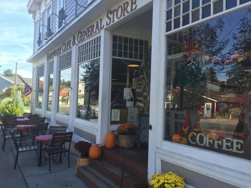 Exterior of Hardware Cafe in the fall in Fair Haven NY