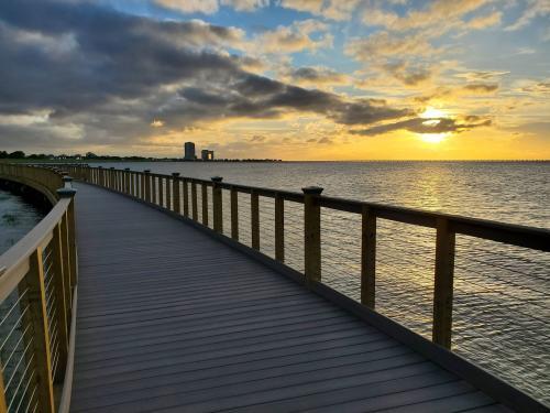 A sunset view from the Bucktown Marsh Boardwalk on Lake Pontchartrain