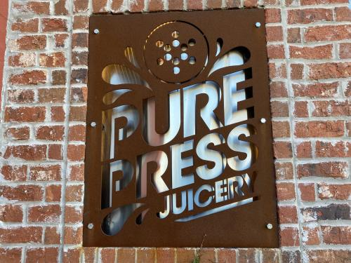 Pure Press Juicery Sign