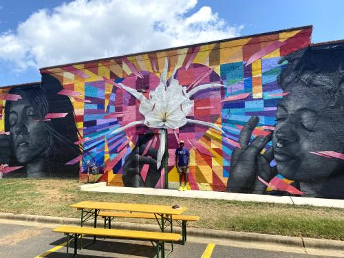 Jamarcus Gaston in front of Warehouse Mural