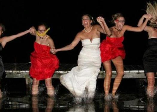 bride jumping in water