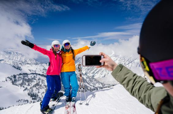 Friends at Snowbird taking a ski photo