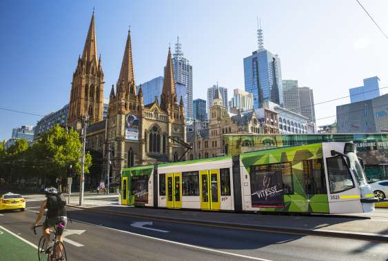 Melbourne Tram with city buildings in background
