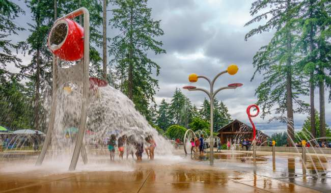 Kids playing in the fountains at Spray Park at Angle Lake Park in SeaTac