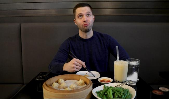 Man sitting at table eating food