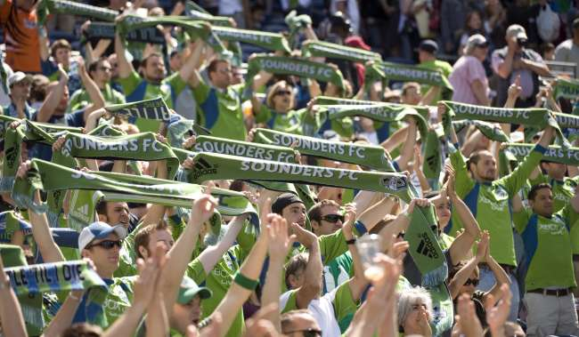 Sounders Soccer Fans cheering and holding up scarves