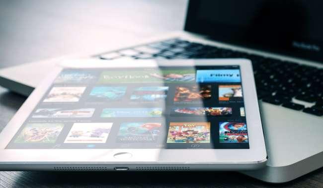 Silver Ipad on Silver Macbook Pro