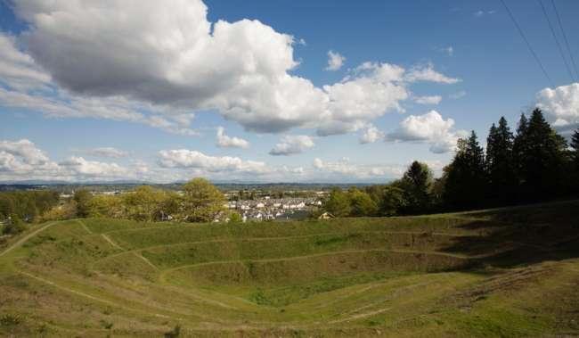 Robert Morris Earthwork public art under blue sky and clouds