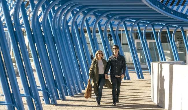Couple Walking at Angle Lake Light Rail Station