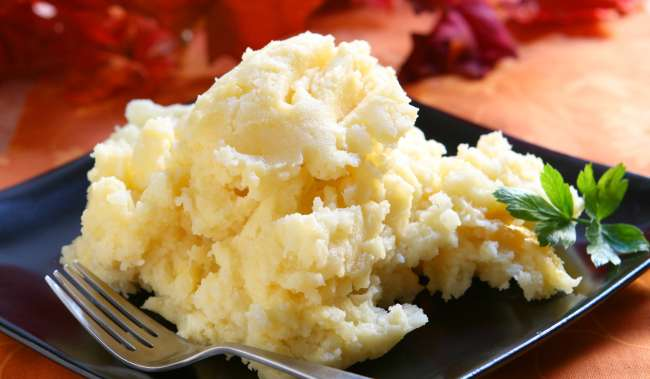 Mashed Potatoes and White Cheddar Cheese on plate with fork