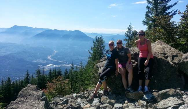 Women atop Mount Si with view of trees and North Bend