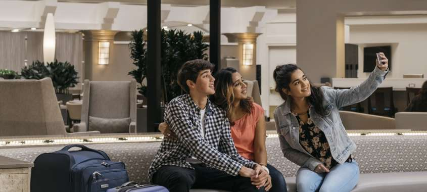 Family in Hotel Lobby Taking a Selfie