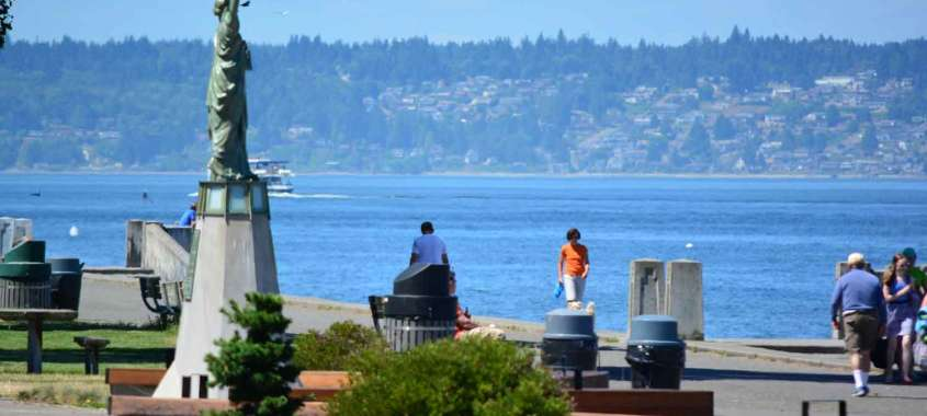 Small statue of liberty overlooking Alki Beach Park