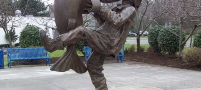 Big Catch Plaza Statue in Des Moines Washington of Giant Fish and Man Kissing