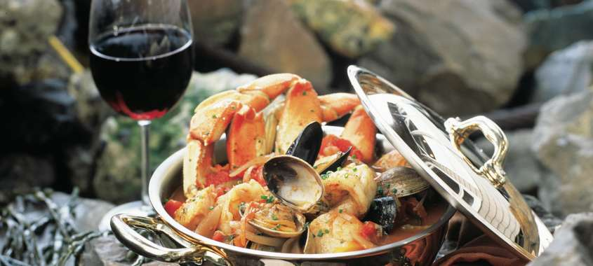 Salty's Pacific Northwest Cioppino  (Seafood Stew) with glass of wine