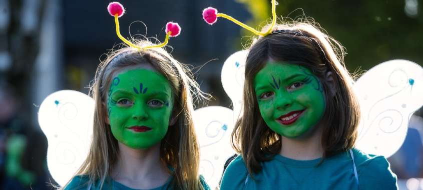 2  young girls with green faces at Burien UFO Festival in Washington