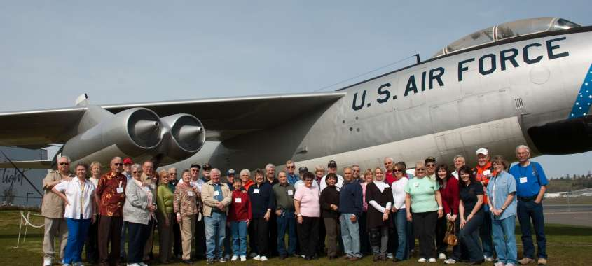 Large reunion gathered in front of Air Force Jet at The Museum of Flight