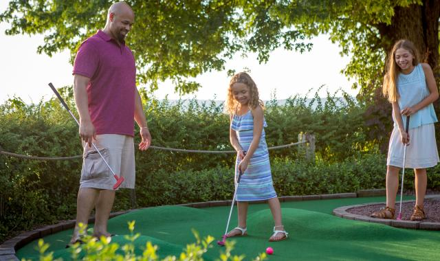 Family Playing a round at Water Golf