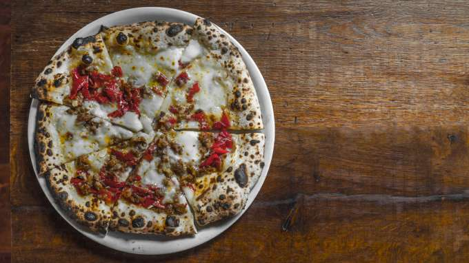 Personal pizza on a wooden table for Oakland Restaurant Week 2020