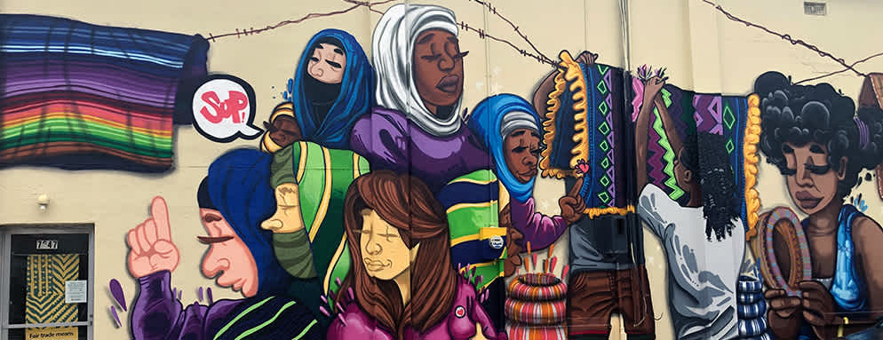 Wall mural of different women and cultures in Overland Park