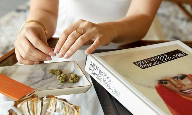 Blüm Dispensary woman holding marijuana bud