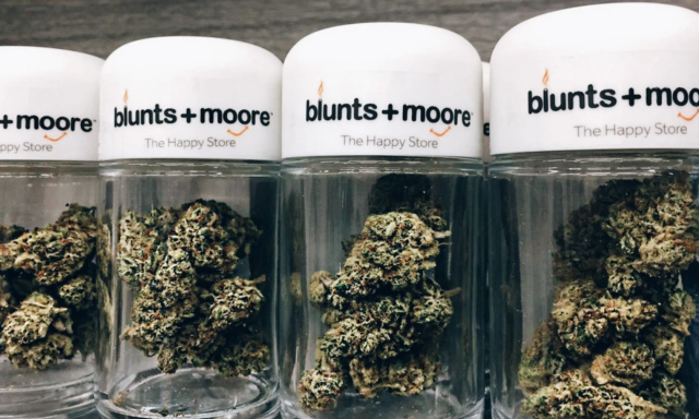 Blunts + Moore Dispensary marijuana in branded containers photo