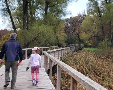 Dad and Daughter Walking on Hackbarth Trail with Dogs in Fall