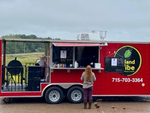 A person getting food from the Island Vibe food truck