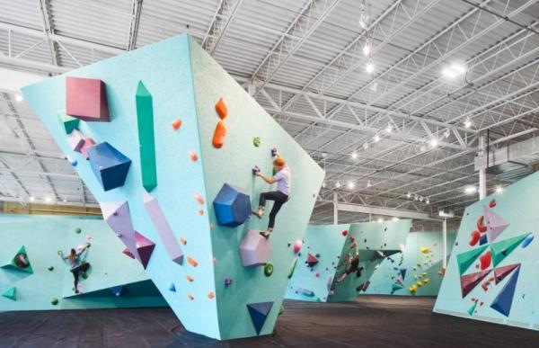 People indoor rock climbing