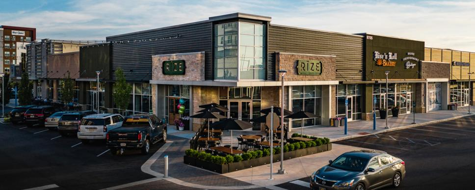 Shopping center in Fishers District with Rize and Rise n' Roll Bakery visible