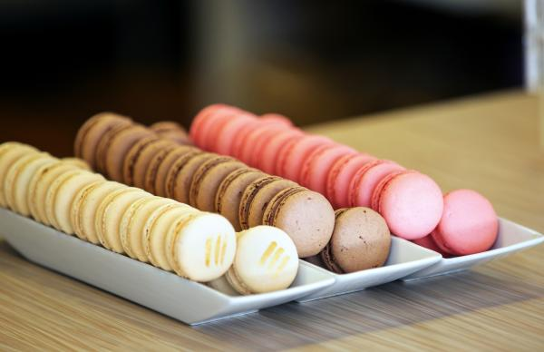 Tray of vanilla, chocolate, and strawberry macarons at The Sweet Boutique Bakery.