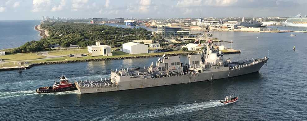 U.S. Navy guided missile destroyer, USS Farragut, makes her way through the Port Everglades entrance channel.