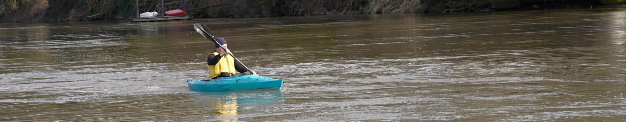 Man Kayaking in River at Duwamish Gardens