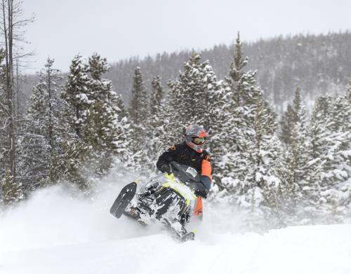 Snowmobiling in the Snowy Range with fresh powder, Albany Lodge rentals