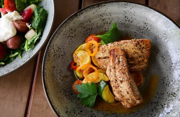 Pyre Provisions' pan seared redfish with heirloom squash, tomato, vinaigrette