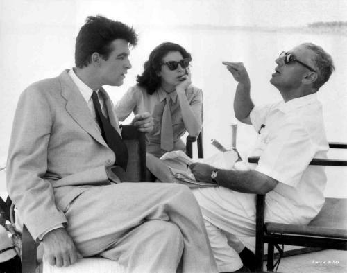 Bill Travers and Ava Gardner sitting on set with and listening to George Cukor, director of Bhowani Junction