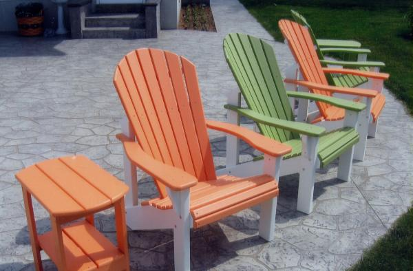 Orange and Green painted chairs and table from B&L Woodcraft on a decorative concrete patio