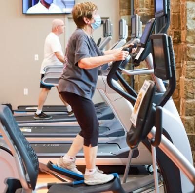Seniors on fitness equipment