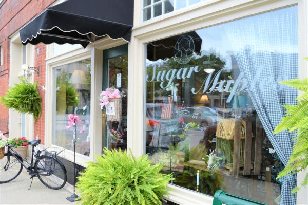Exterior of the Sugar Maples window and entrance