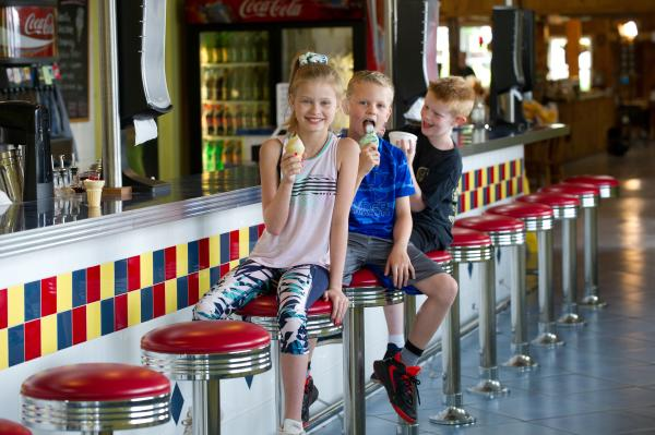 Kids eating ice cream at Joe Huber's Soda Shoppe Ice Cream